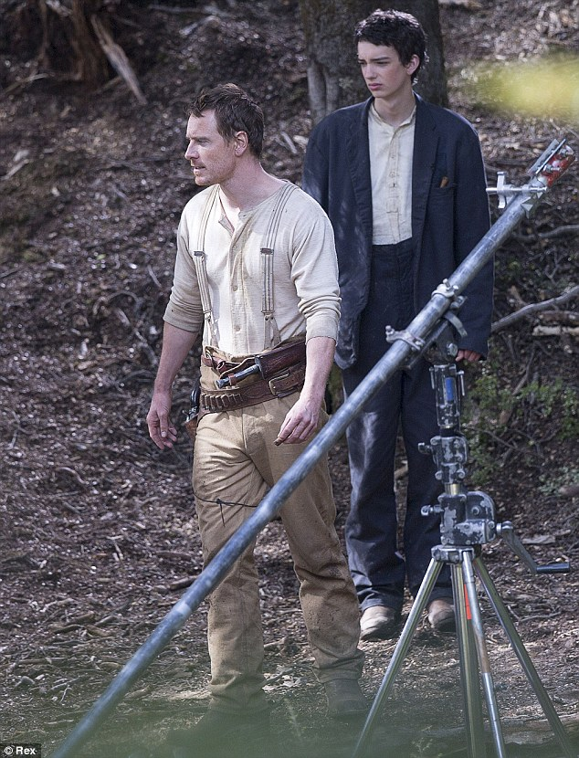 Two's company! Michael Fassbender and Kodi Smit-McPhee on the set of Slow West near Twizel, New Zealand