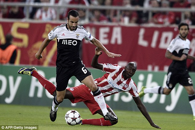 Midfield battle: Benfica's Ruben Amorim (left) vies for the ball with Olympiacos' Sambou Yatadare (right)