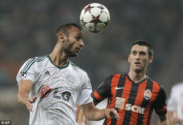 Out of danger: Leverkusen Omer Toprak (left) heads the ball away as Donetsk's Ferreyra Facundo looks on
