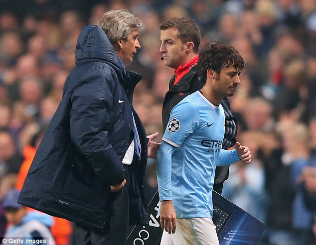 Worry: David Silva looked in some discomfort as he limped off against the Russian club