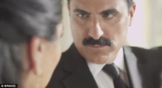 If looks could kill! Reza Farahan gets into character as he scowls for the camera