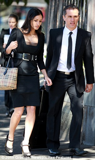 'Sent angry texts': Simon Gittany arrives at court with his new girlfriend during his trial for the murder of his fiancee Lisa Harnum