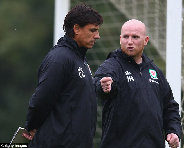 Helping hand: John Hartson steooed down as Chris Coleman's No 2 on Wednesday