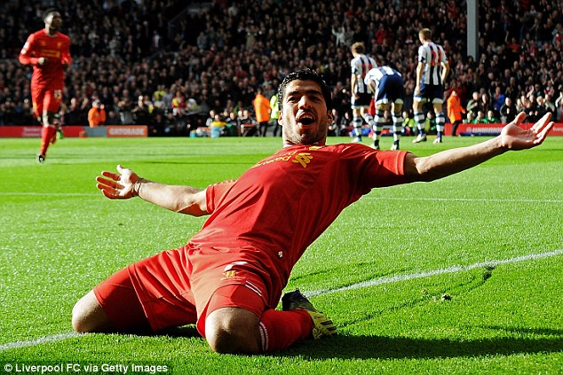 Loving it: With over 2.1m followers, Luis Suarez has more than Liverpool as a club do