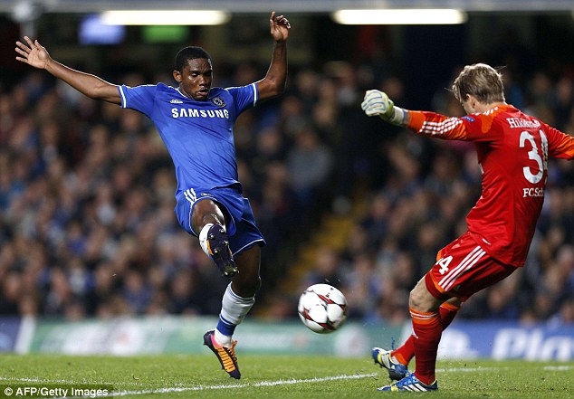 Too quick: Samuel Eto'o blocks Timo Hildebrand's attempted clearance to give Chelsea the lead