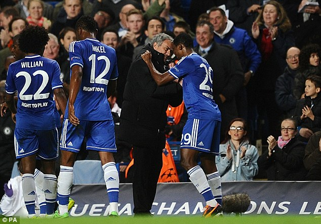 Mutual appreciation: Eto'o celebrates with manager Jose Mourinho after giving Chelsea the lead