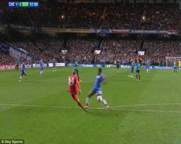 Blocked: Eto'o gets in the way of Hildebrand's kick as he attempts to clear the ball
