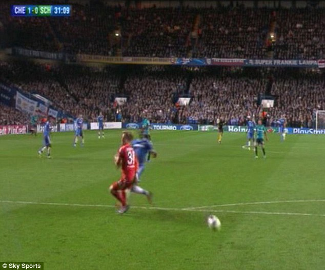 Going in: Eto's block sends the ball flying into the back of the Schalke net to give Chelsea the lead