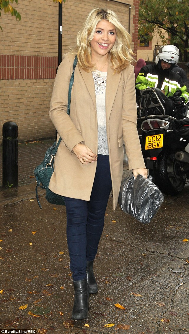 Classic: Holly Willoughby arrived in a cream winter coat with blue skinny jeans and a white knitted jumper