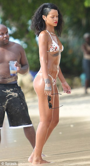 Rihanna is spotted at the beach doing a photoshoot in Barbados