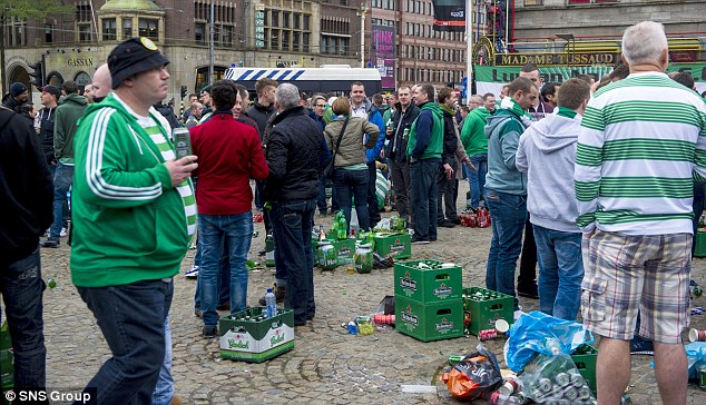 Calm before the storm: Celtic fans have a pre-match party in Amsterdam before their game with Ajax
