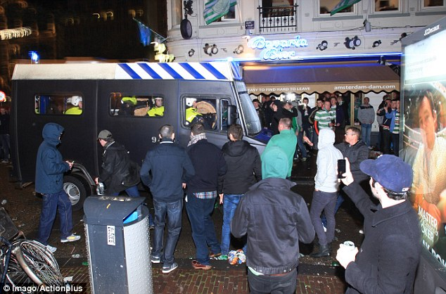 Presence: A riot van rolls down the street in the centre of Amsterdam before the game
