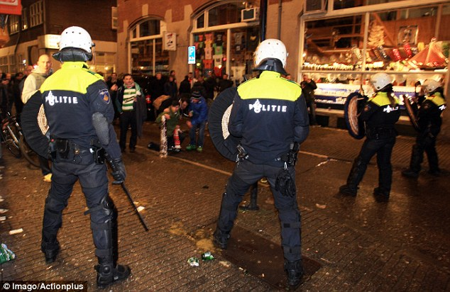 Riot gear: Police, equipped with shields and batons, try to contain some supporters in Dam Square