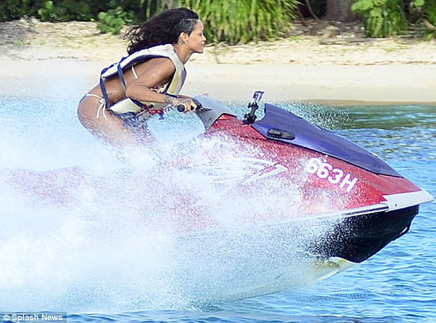 She could be a Bond girl: The Diamonds hit-maker was in her element on the high-speed vehicle