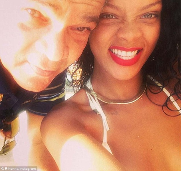 Family time: Rihanna also posted a selfie of herself and her father