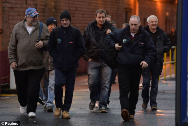 Going home: Shipworkers leave the BAE systems yard at Govan on the river Clyde in Glasgow tonight