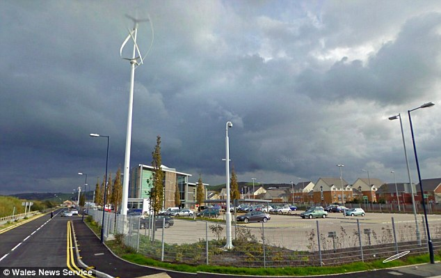 Waste of money: This taxpayer-funded 60ft wind turbine has been producing just £5 of electricity a month - because it was put up in an area of Aberystwyth where there is very little wind