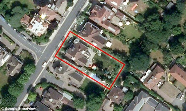Aerial view: The 'Iceberg Home' would extend into the garden of the  Wimbledon mansion (highlighted in red)