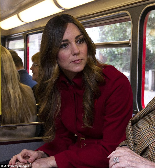 The Duchess of Cambridge, who left her hair long and loose, with blonde highlights (and a hint of grey) coming through the chestnut, rides a 1960s Routemaster bus as part of the London Poppy Day events
