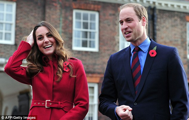 Kate pulls her hair away from her face and enjoys a laugh as she and Prince William arrive to meet staff and volunteers