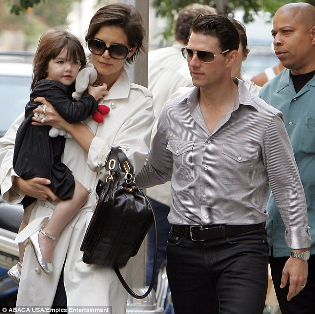 In happier times: Tom and Kate are seen doting over their daughter Suri in New York in 2008 during Katie's rehearsals for the Broadway play All My Sons