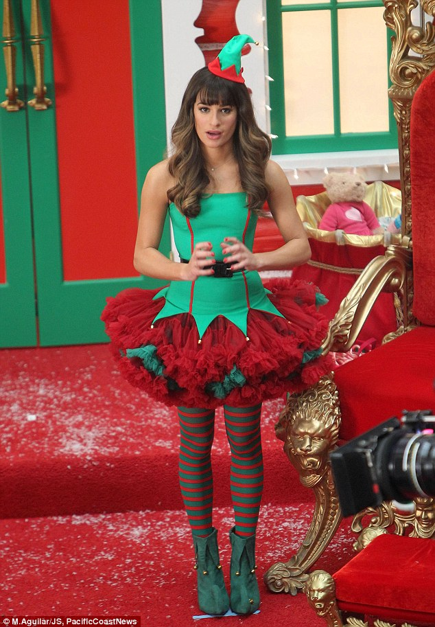 Naughty or nice? The 27-year-old clearly falls into the latter category, looking sweet in her green strapless bodice and red and green tutu, worn over striped stockings and green boots, and with a miniature hat