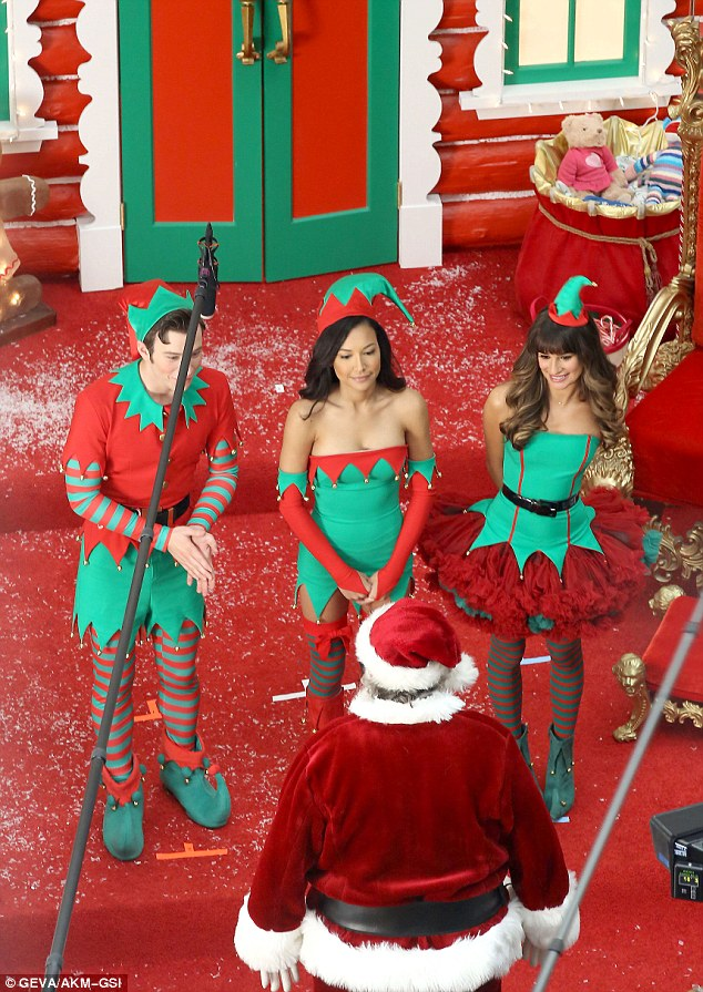 It's a Christmas miracle! Kurt (Chris Colfer), Santana and Rachel (from left) looked pleased as punch to stand before the man himself, Santa