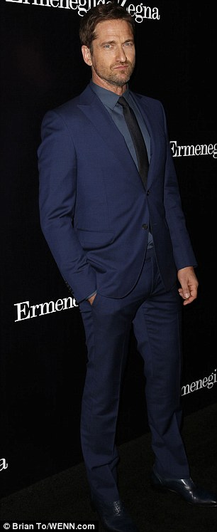 Gerry-mandering: Rugged Butler set himself apart from grey suit wearers such as Ethan Peck by donning blue