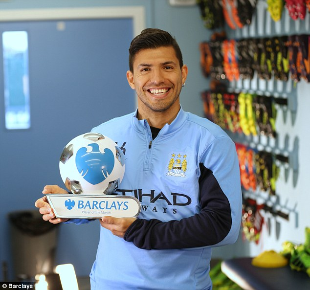 On the money: Manchester City's Sergio Aguero receives his player of the month award for impressive form in front of goal