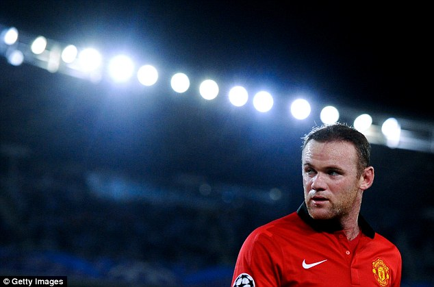 Underwhelmed: Wayne Rooney insisted we should wait until March before judging Arsenal's credentials