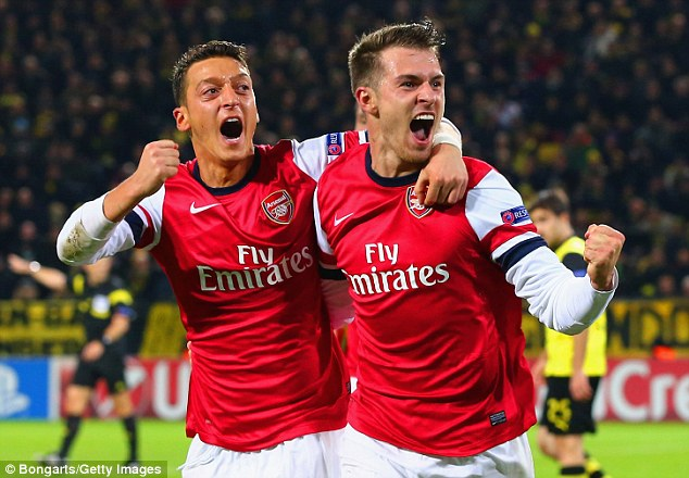 We can do it: Aaron Ramsey (right) believes Arsenal could win the Premier League this season