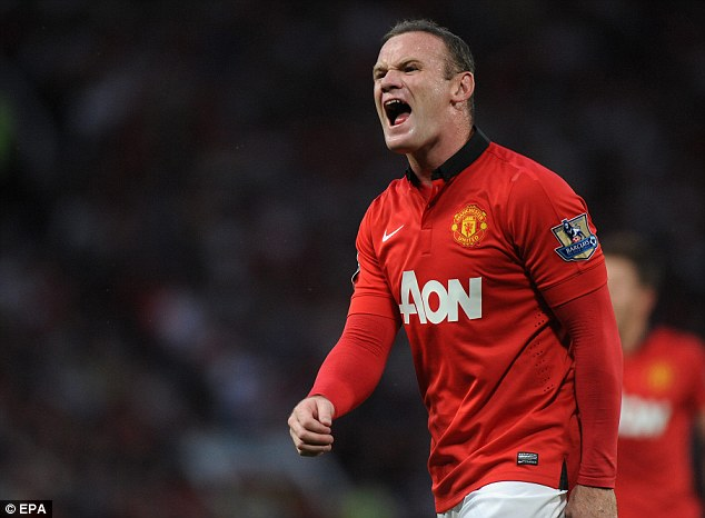 Roaring success: Manchester United striker Wayne Rooney says Arsenal must be sick of the sight of him