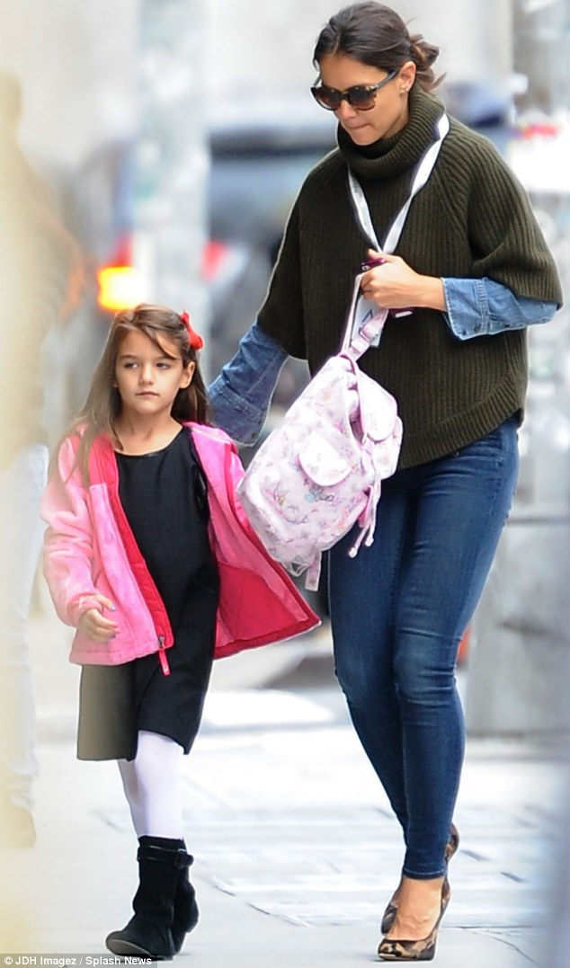 School girls: Suri is pictured being dropped off at her $40,000-a-year private school in Chelsea, Manhattan by her mother Katie Holmes, 34, late last month