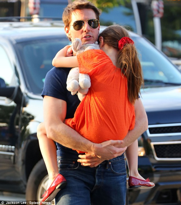Daddy's girl: Tom Cruise, pictured with Suri last year, claims he would have been there for his daughter's first day of school had she asked him