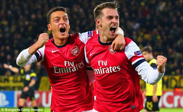 Midfield Maestros: Arsenal, with Mesut Ozil (left) and Aaron Ramsey, are five points clear at the top of the league