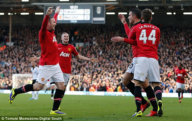 On the attack: Rooney (left) has formed a striking partnership with former Gunner Robin van Persie