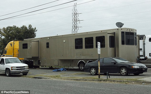 Mobile home: Will Smith's smaller trailer is seen on the set of 'Focus' in New Orleans where he is alleged to have 'carried Margot back toeen on the set of 'Focus' in New Orleans
