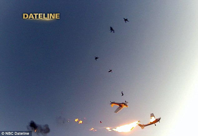 Incredible: Five of the skydivers involved in the Wisconsin plane crash on Saturday fall from the sky after the aircraft accidentally collided, causing one to erupt in flames