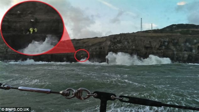Rescue: Two RNLI coastguards, circled, stand just above the cave where Charlotte Furness-Smith was trapped