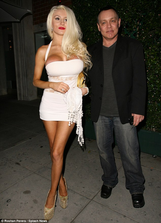 Rocky marriage: Courtney and Doug (pictured in July 2013) announced they were amicably splitting up in November