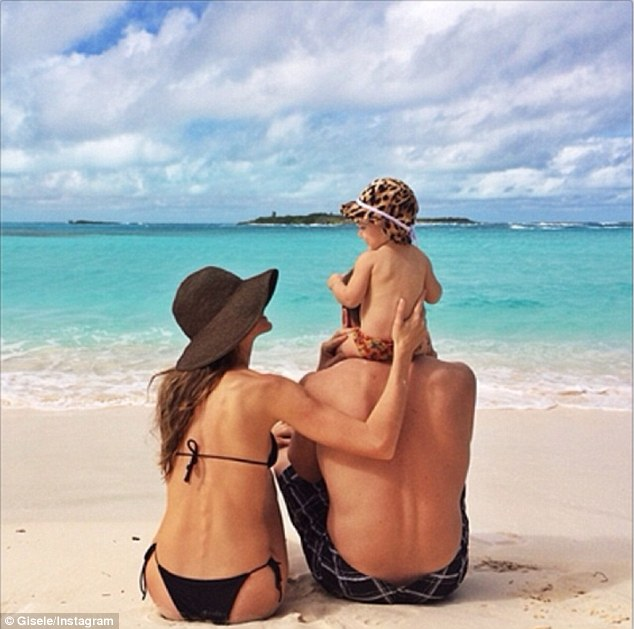 Beach life: Gisele Bundchen posted a photo with husband Tom Brady and daughter Vivian Lake on her Instagram and Facebook accounts on Saturday