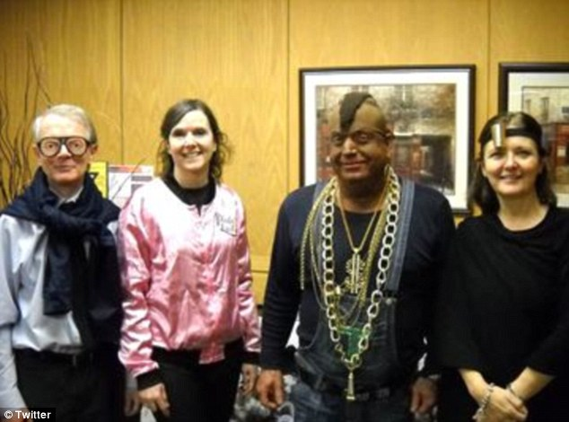 Principals: A Toronto school board received complaints from students, staff and the public about their vice principal (second from right) Lionel Klotz's choice of costume