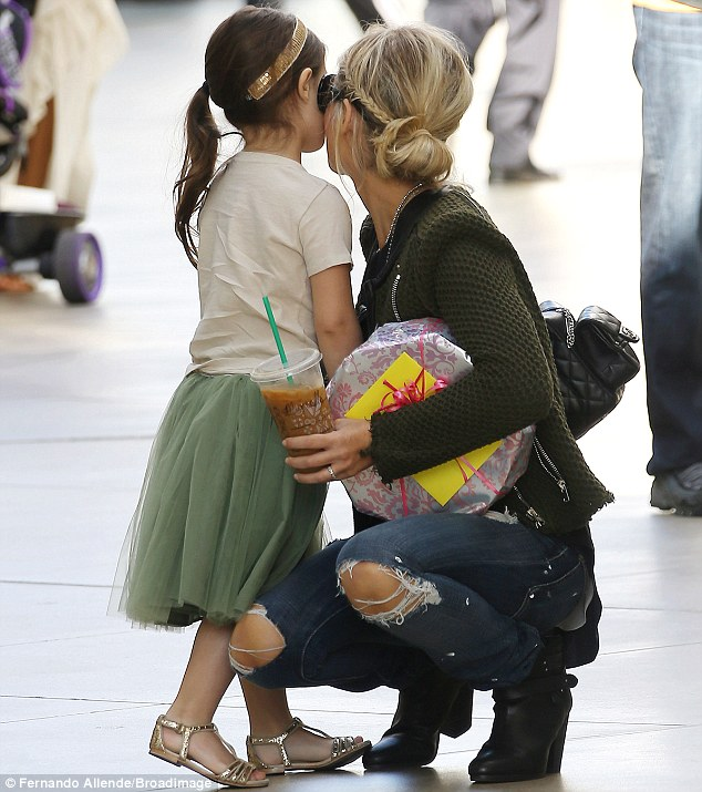 Kisses for mum: Charlotte cuddled closely with her Buffy The Vampire Slayer star mother in the middle of the open-air mall