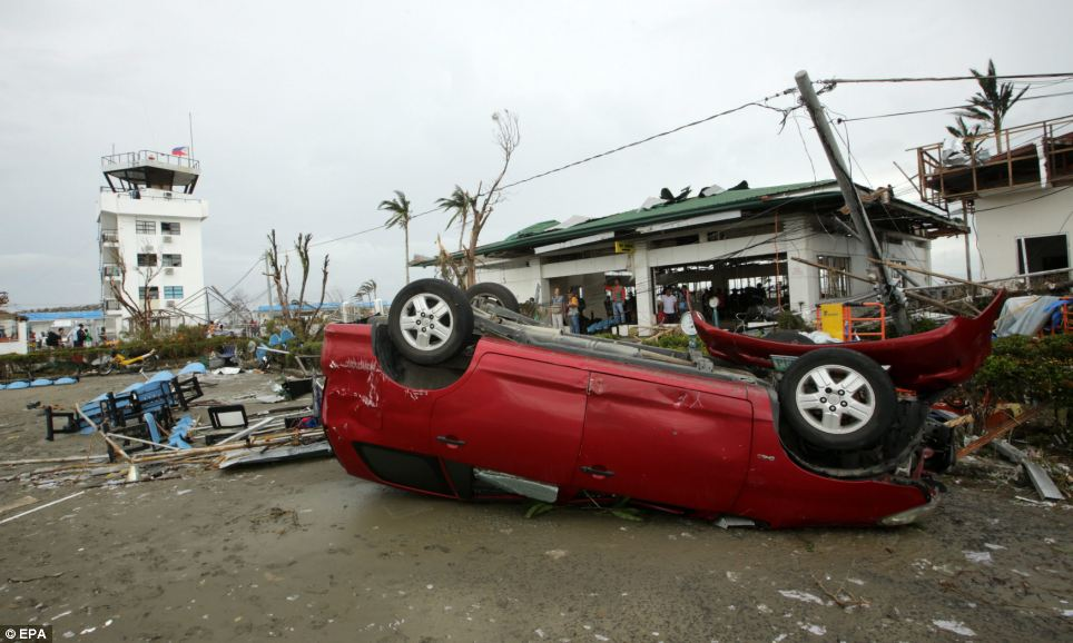 Upside down: A devastated airport in Tacloban city, Leyte province - where roofs were ripped on hundreds of houses