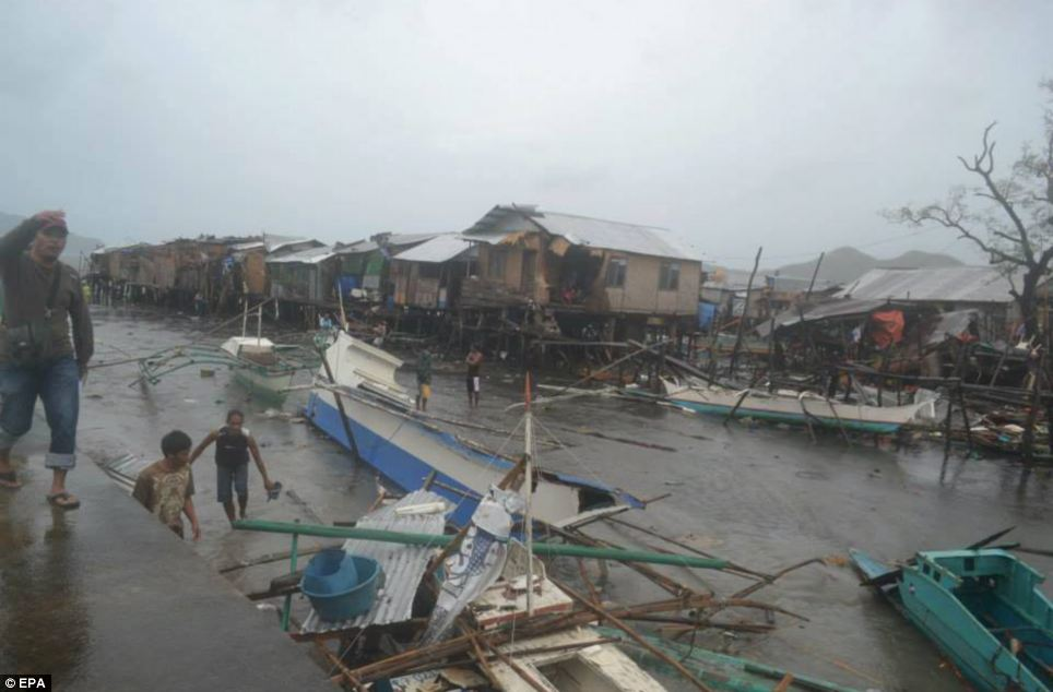 Flooding: Locals in Coron, Palawan walk among damaged buildings after the typhoon - the most powerful in three decades