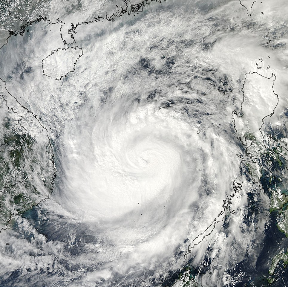Satellite: A picture posted on Twitter by NASA at 8.00pm GMT shows the centre of the moving across the South China Sea towards the coast of Vietnam