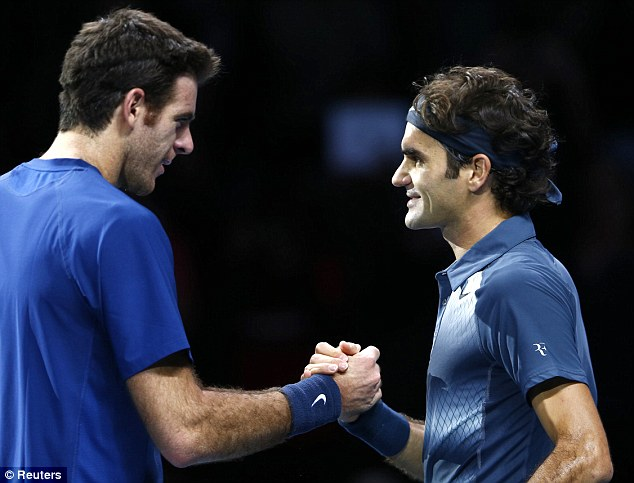 Embrace: Federer beat Del Potro in front of a packed house at The O2 Arena