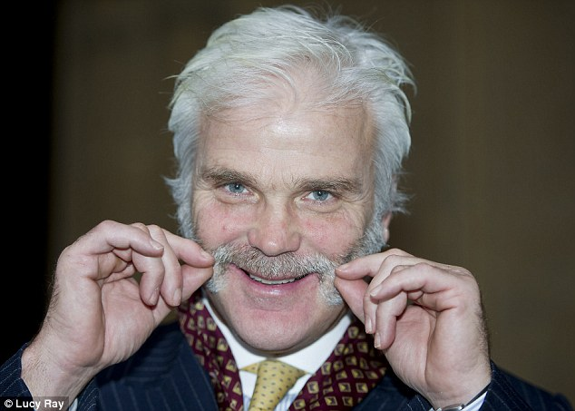 MP Desmond Swayne shows off his moustache at Westminster