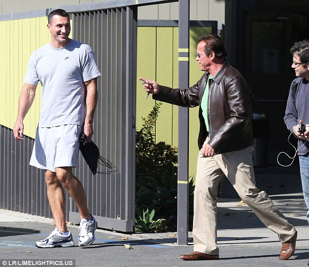 Wait for me! The 66-year-old former Governor of California chased after his long-legged fighter pal