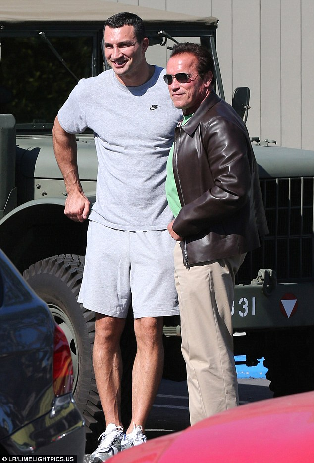 Hello up there! Arnold Schwarzenegger took his fellow muscular pal Wladimir Klitschko - who is engaged to Hayden Panettiere - for a spin in his car on Saturday, only to have him tower a head above him